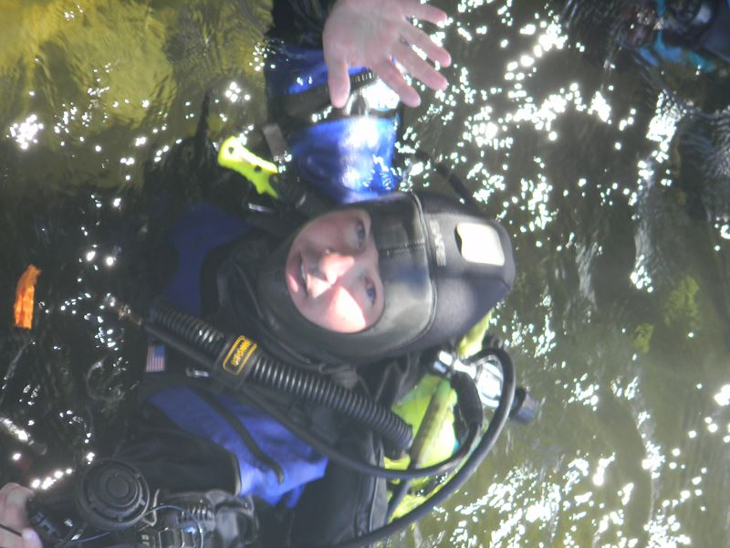 Diver in Water Waving to the Camera
