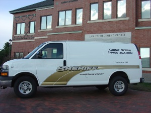 Crime Scene Investigation Division van parked in front of the Law Enforcement Center